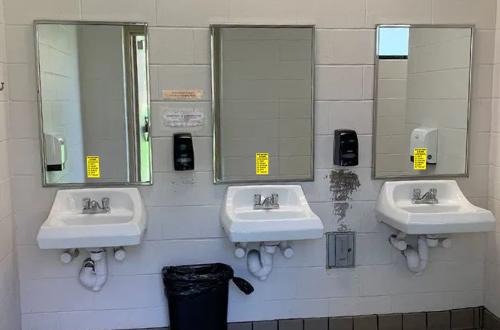 hand washing decals on three sinks