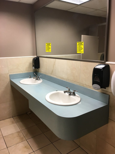 hand washing decal with two sinks